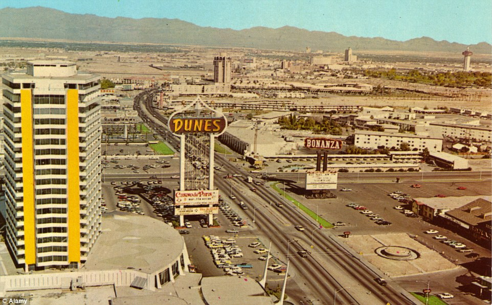The main strip in Las Vegas during the golden era hints at its potential for growth. The open expanse reveals the desert backdrop in all its glory and the Dunes Hotel is the only focal point in the foreground.