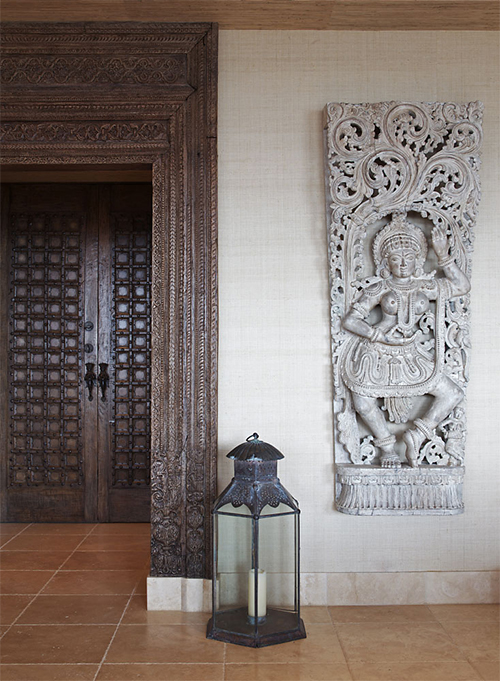 Intricate Indian sculptures and artefacts bring subtle luxury to an Indian minimalist's home