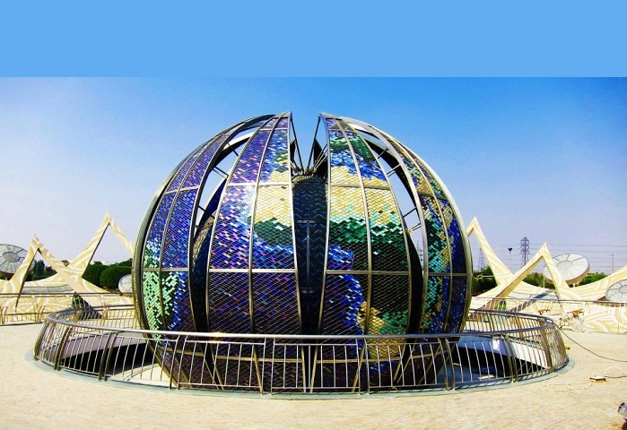 Stained glass double globe of the Earth in the middle of the Fountain of Oneness at Nirankari Sarovar Complex, Delhi