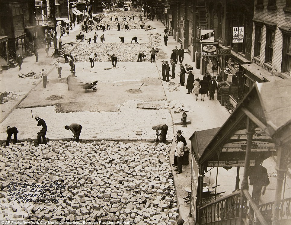 Workers lay bricks to pave 28th Street in Manhattan on October 2, 1930/
